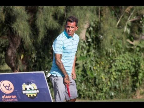 Argentine professional footballer Carlos Tevez about to hit the golf course at Tryall in Hanover, Jamaica, yesterday.