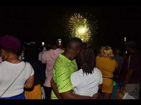 Narmeo and Tashana take in the fireworks after a spectacular marriage proposal.