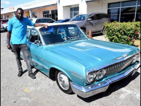 Glenford Thorpe with his 1963 Chevrolet Impala.