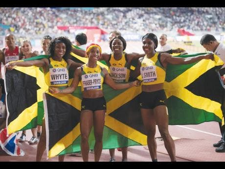 From left: Natalliah Whyte, Shelly-Ann Fraser-Pryce, Shericka Jackson, and Jonielle Smith moments after victory in the women's 4x100m relay final at the World Athletics Championships at the Khalifa International Stadium in Doha, Qatar on Saturday, October 5, 2019.