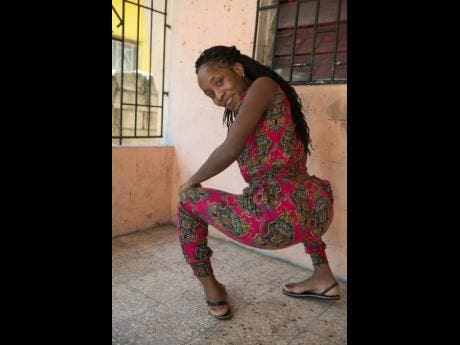Marshalee Brown dancing at her home in Drewsland, St Andrew.