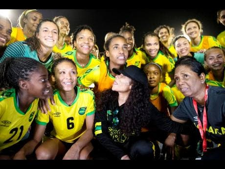 Cedella Marley (front, second right), team manager Jean Nelson (front right), and Reggae Girlz moments after the team's victory in the international friendly against Panama at the National Stadium in Kingston on Sunday, May 19, 2019.