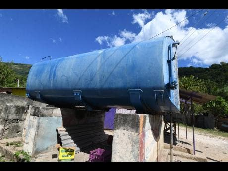 Ricardo Makyn/Chief Photo Editor This tank holds the community's water when the trucks are able to bring the precious commodity.