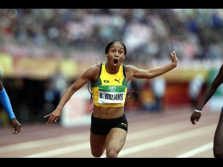Briana Williams, of Jamaica, crosses the finish line to win the women's 100-metre race at the 2018 IAAF World U20 Championships in Tampere, Finland, on Thursday, July 12, 2018.
