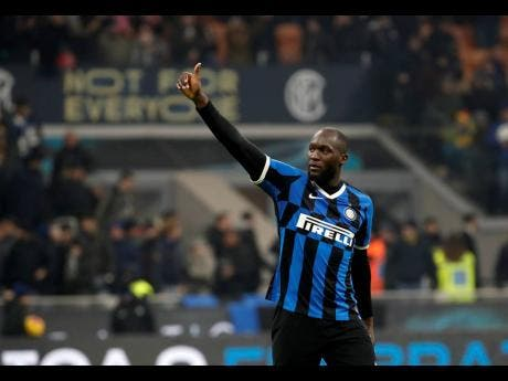 Inter Milan's Romelu Lukaku waves to supporters at the end of an Italian Cup match between Inter Milan and Cagliari at the San Siro stadium, in Milan, Italy yesterday.