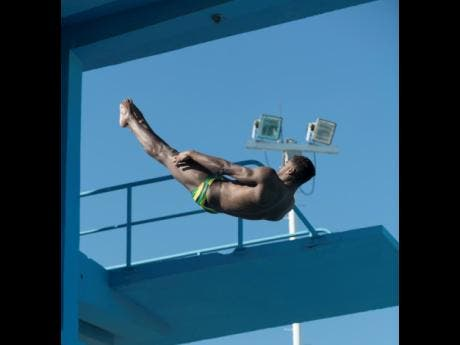 Knight-Wisdom midair after leaping off the diving platform at the National Aquatic Centre in Kingston on Thursday.