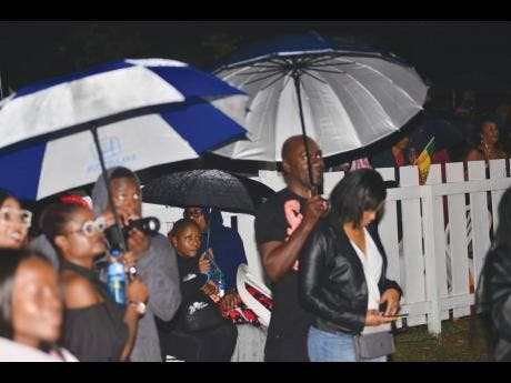 The umbrellas came out at Rebel Salute.