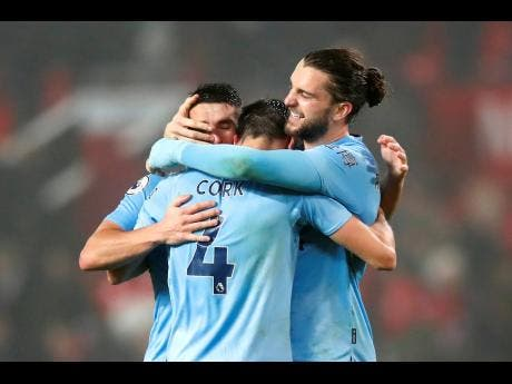 Burnley's Jay Rodriguez (right) celebrates with his teammates at the end of the Premier League match at Old Trafford, Manchester,  yesterday.