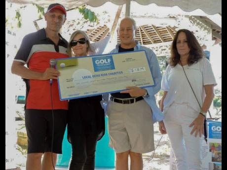 From left:  Glenn Lawrence, CEO of Couples Resorts; Maureen Sheridan, director of Animal House; Paul Issa, deputy chairman of Couples Resorts and Alex Ghisays, Group PR Director of Couples, pose with the ceremonial cheque following the resorts Charity Golf Tournament in Ocho Rios.