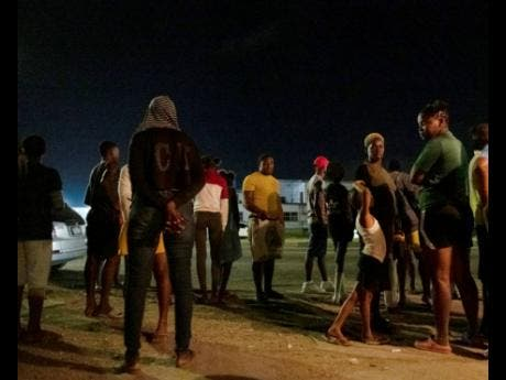 Residents of Richie Lane, off Spanish Town Road, react angrily to the news of Gallen's death.