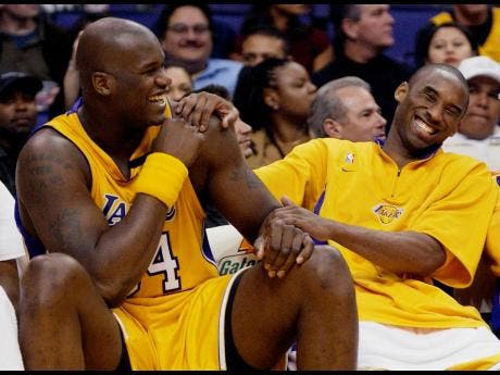 FILE - In this April 15, 2003, file photo, Los Angeles Lakers Shaquille O'Neal, left, and Kobe Bryant share a laugh on the bench while their teammate take on the Denver Nuggets during the fourth quarter at Staples Center in Los Angeles.