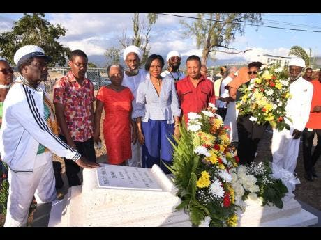 Members of the Twelve Tribes of Israel, the Dennis Brown Foundation and beloved family members of the Crown Prince of Reggae gather at the shrine of late reggae legend, Dennis Brown, during a cultural gathering to celebrate his 63rd birthday.