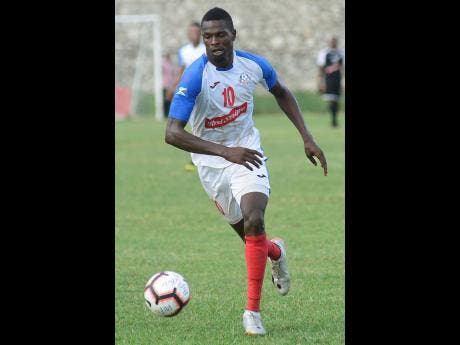 Portmore United's Corey Burke dribbles the ball during his team's 2-0 win over Mount Pleasant in the Red Stripe Premier League on November 24, 2019.