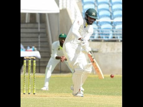 Jamaica Scorpions captain John Campbell plays a shot during his century against the Windward Islands Volcanoes at Sabina Park recently.