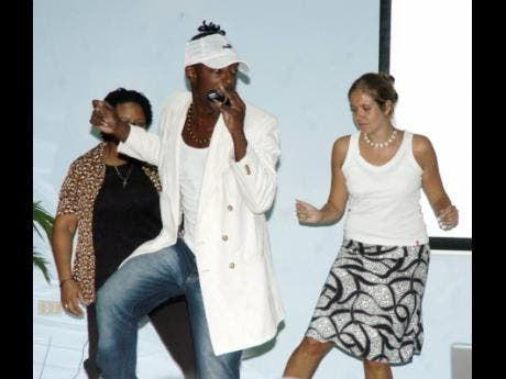 Tippa (centre) teaches a few dance steps to participants at a symposium held at the University of the West Indies in 2007.