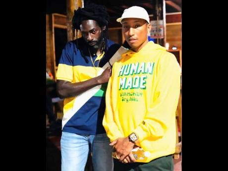 Buju Banton (left) shares this picture of himself and Pharrell Williams with his one million followers on Instagram.