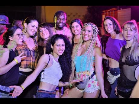 In this 2018 photo, Popular dancer Boysie Roses (at centre back) with a group of ladies from California.They were guests of the dancer at the 'Sex in D City' party held at the dock, Kingston waterfront.