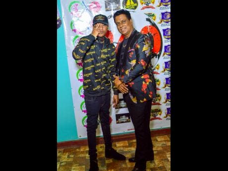 Dancehall artist Ace Gawd (left) with Percival Buddan CEO of 360 Global Entertainment.