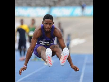 Kingston College's Shaquille Lowe produces a big jump as he wins the Class Two Long Jump final at the 2017 ISSA/GraceKennedy Boys and Girls' Athletics Championships.