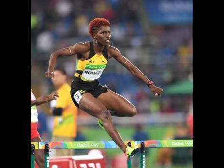 Janieve Russell clears a hurdle during competition at the Rio de Janeiro Olympic Games in 2016.