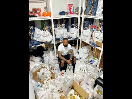 Onfroy surrounded by care packages that he gives to those in need.