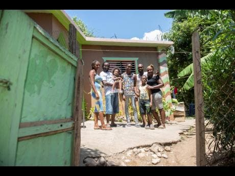 From left: Danielle Townsend-McLean, Havard McLean, Haile McLean, Malique Wilkie, Ruel Wilkie, Jourdain Wilkie and Juile-Ann Whyte Wilkie at their home in Shooters Hill, Bull Bay, St Andrew, on Saturday.