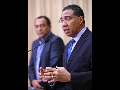 Prime minister Andrew Holness (right) with Minister of Health and Wellness, Dr Christopher Tufton.