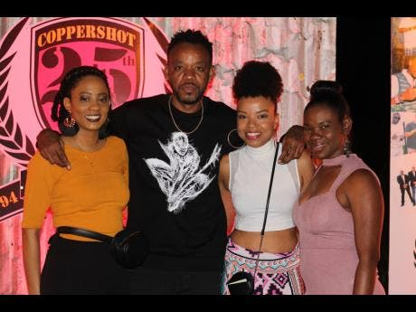 From left: Tamiann Young, Angella Byfield and Kahlia Lawrence pose with veteran artiste, Ward 21's Suku.