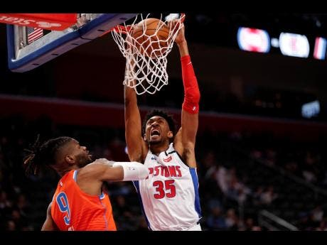 Detroit Pistons forward Christian Wood (35) dunks on Oklahoma City Thunder centre Nerlens Noel  during the first half of an NBA basketball game in Detroit on Wednesday, March 4.
