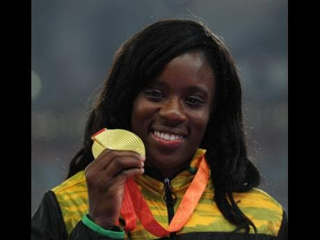 A proud Danielle Williams displays her gold medal.