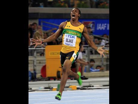 file Yohan Blake  winning gold in the men's 100m final at the World Athletics Championships in Daegu.