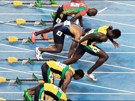 Usain Bolt (third from bottom), false-starts in the men's 100-metre final at the World Athletics Championships in Daegu, South Korea.