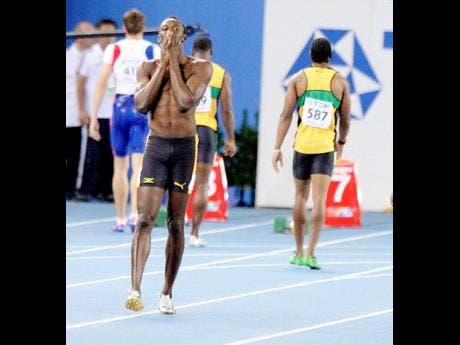 Usain Bolt reacts after he false-started in the men's 100m final at the World Championships in 2011.