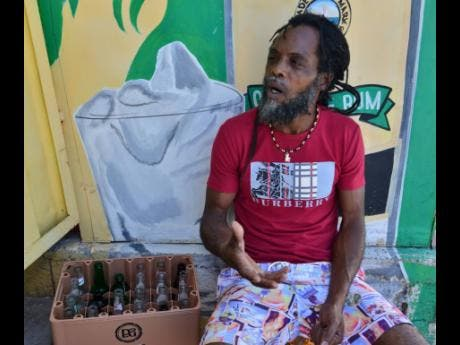 Marvin Hibbert, a self-taught artist from Trench Town.