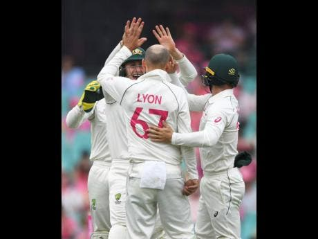 Australia's Nathan Lyon (67) celebrates with teammates after bowling New Zealand's Tom Blundell on day three of the third cricket test match between Australia and New Zealand at the Sydney Cricket Ground in January.