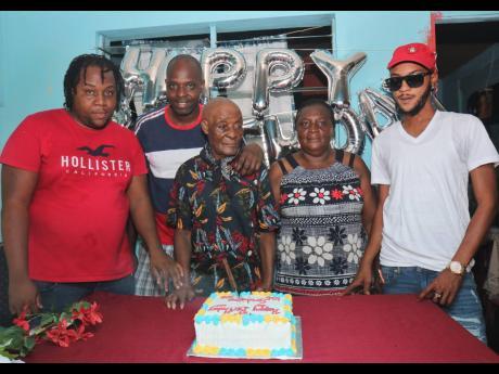 From left: Kadian Neil (grandson), Ryan Patman (grandson), Uton Samuels, Pearlina Samuels (daughter) and Everton Neil (grandson)