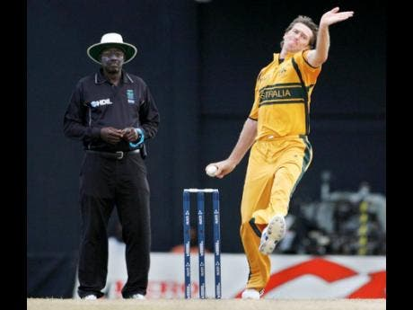FILE Australia's McGrath (right), bowls against Scotland as umpire Steve Bucknor of the West Indies watches during their World Cup match in St Kitts in March 2007.