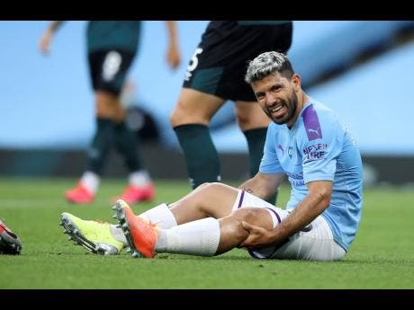 Manchester City's Sergio Aguero reacts as he sits on the pitch injured during the English Premier League match between Manchester City and Burnley at Etihad Stadium in Manchester, England, on Monday, June 22, 2020.