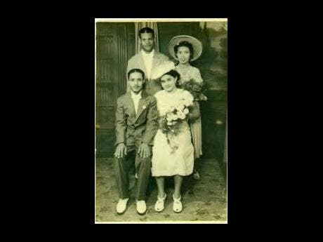 Alburn (seated, left) and Lola (seated, right) on their weddng day with Vernice Miller and Herbert Morris, Alburn's sister and her husband.