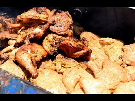 This curried jerked chicken was a big hit at a farmers' market that was held at Denbigh in Clarendon last Friday.