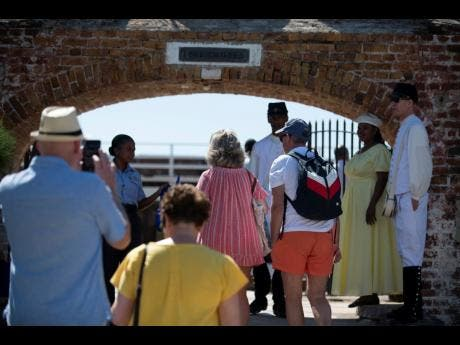 Scores of tourists arrive in Port Royal in February.