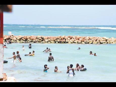 Beachgoers at the Hellshire Beach in St Catherine yesterday.