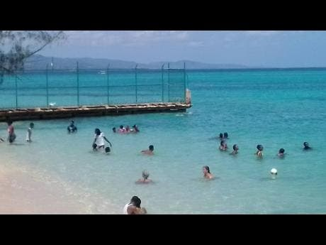 Beach goers make use of this Montego Bay beach.