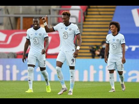Chelsea's Tammy Abraham celebrates after scoring his side's third goal during the English Premier League match between Crystal Palace and Chelsea at Selhurst Park, in London, England, Tuesday, July 7, 2020.