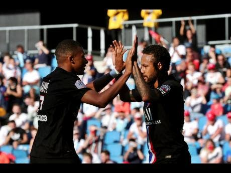 Paris Saint Germain's Neymar (right) celebrates with teammate Kylian Mbappe after he scored a goal during a friendly  match between Paris Saint Germain and Le Havre, in Le Havre, western France, Sunday, July 12, 2020.