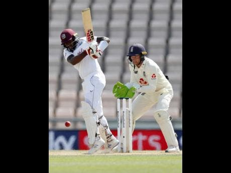 Jermaine Blackwood (left) plays a shot during the fifth day of the first cricket Test match between England and West Indies at the Ageas Bowl in Southampton, England, Sunday, July 12, 2020.