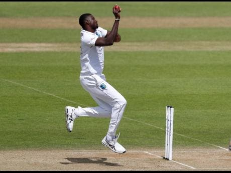 Windies' captain Jason Holder in stride delivering a ball during the fourth day of the first cricket Test match against England at the Ageas Bowl in Southampton, England, on Saturday.