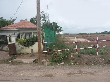 The extension of the East-West highway from May Pen, Clarendon, to Williamsfield, Manchester, runs close to Careem Pinnock's house in Four Paths, Clarendon.