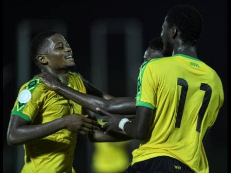 Reggae Boyz striker Leon Bailey (left) celebrates with  Devon Williams (partially hidden) and Shamar Nicholson during Jamaica's Concacaf Nations League match against Antigua and Barbuda at the Montego Bay Sports Complex on  September 6,2019.