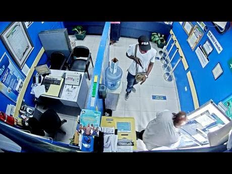 Camera footage shows the robbery in progress at the JN Bank branch in Whitehouse, Westmoreland yesterday.